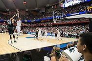 27 MAR 2015: Denzel Valentine (45) of Michigan State University shoots a three over Buddy Heild (24) of the University of Oklahoma during the 2015 NCAA Men's Basketball Tournament held at the Carrier Dome in Syracuse, NY. Michigan State defeated Oklahoma 62-58. Brett Wilhelm/NCAA Photos