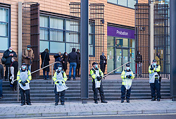 © Licensed to London News Pictures; 25/01/2021; Bristol, UK. Colston Four at court. Police in PPE against Covid stand outside court. Defendants Rhian Graham, 29, Milo Ponsford, 25, Jake Skuse, 32, and Sage Willoughby, 21, are due before Bristol Magistrates' Court for their first hearing today. They have been charged with criminal damage in connection with damage to the statue of slave trader Edward Colston which was pulled down during a Black Lives Matter protest on June 7 2020 and then thrown into Bristol Harbour. Police launched an appeal to trace suspects after the event and ten people were located. Six people accepted a caution while four were referred to the CPS. The statue was later retrieved by Bristol City Council who say that the damage is costed at £3,750. Police have warned anyone planning to protest at the court hearing that they will be breaking the lockdown laws which prohibit public gatherings of more than two people to combat the Covid-19 coronavirus pandemic. Photo credit: Simon Chapman/LNP.