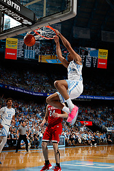 CHAPEL HILL, NC - FEBRUARY 05: Garrison Brooks #15 of the North Carolina Tar Heels dunks the ball during a game against the North Carolina State Wolfpack on February 05, 2019 at the Dean Smith Center in Chapel Hill, North Carolina. North Carolina won 113-96. North Carolina wore retro uniforms to honor the 50th anniversary of the 1967-69 team. (Photo by Peyton Williams/UNC/Getty Images) *** Local Caption *** Garrison Brooks