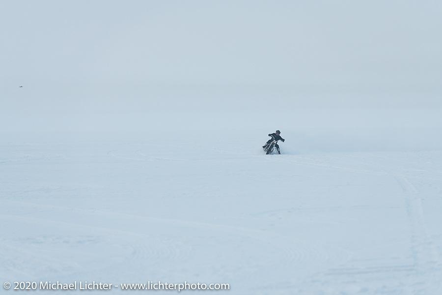 Photographer Aleksei Kalabin of Moscow having fun in the snow on his Kawasaki w650 racer during the Baikal Mile Ice Speed Festival. Maksimiha, Siberia, Russia. Saturday, February 29, 2020. Photography ©2020 Michael Lichter.
