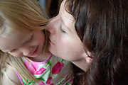 Polish mom nuzzling unhappy daughter age 32 and 4. Zawady Central Poland
