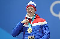 PYEONGCHANG,SOUTH KOREA,16.FEB.18 - OLYMPICS,BIATHLON - Olympic Winter Games PyeongChang 2018, Medals Plaza, 20km biathlon, men, award ceremony. Image shows Johannes Thingnes Bøe (NOR). <br /> <br /> Norway only