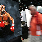 LAS VEGAS, NV - SEPTEMBER 13: An attendee walks past a painting of Floyd Mayweather Jr. during the Box Fan Expo at the Las Vegas Convention Center on September 13, 2014 in Las Vegas, Nevada.   (Photo by Alex Menendez/Getty Images) *** Local Caption *** Floyd Mayweather Jr.
