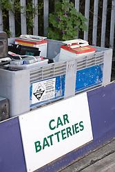 Old car batteries in bin at city tip,
