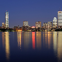 Boston skyline photos are available as museum quality photography prints, canvas prints, acrylic prints or metal prints. Prints may be framed and matted to the individual liking and decorating needs:<br /> <br /> http://juergen-roth.artistwebsites.com/featured/boston-skyscrapers-juergen-roth.html<br /> <br /> Boston skyline photography at twilight showing landmarks such as John Hancock building, Prudential Center, Sheraton Hotel, and 111 Huntington Avenue as seen from Memorial Drive in Cambridge on a beautiful night. <br /> <br /> Good light and happy photo making!<br /> <br /> My best,<br /> <br /> Juergen<br /> Art Prints: www.RothGalleries.com<br /> Image Licensing: www.ExploringTheLight.com<br /> Twitter: @NatureFineArt<br /> Facebook: https://www.facebook.com/naturefineart