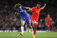 Daniel Sturridge of Liverpool and David Luiz of Chelsea compete for the ball. Premier league match, Chelsea v Liverpool at Stamford Bridge in London on Friday 16th September 2016.<br /> pic by John Patrick Fletcher, Andrew Orchard sports photography.