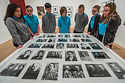 Pupils from Thomas Tallis School in Kidbrooke who are doing Russian studies, visit the exhibition and look at pictures of political prisoners - Tate Modern's new exhibition Red Star Over Russia on the 100th anniversary of the October Revolution. The exhibition offers a visual history of the Soviet Union, revealing how seismic political events inspired a wave of innovation in art and graphic design. Featuring over 250 posters, paintings and photographs, many on public display for the first time, the exhibition will provide a chance to understand how life and art were transformed during a defining period in modern world history.