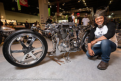 """Omar Jumiran of Eastern Bobber Custom Cycle with his """"Bone-X"""" 1969 AJS 350 entirely handmade custom. (Check out his unique front and rear suspension. He calls the front end a """"Single-Side Dual-Arm""""!)   Shown here in the AMD World Championship of Custom Bike Building in the Intermot Customized hall during the Intermot International Motorcycle Fair. Cologne, Germany. Friday October 5, 2018. Photography ©2018 Michael Lichter."""