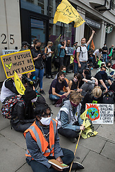 London, UK. 3rd September, 2020. Animal rights activists from Animal Rebellion show solidarity with fellow activists who had locked themselves to the top of and inside a pink slaughterhouse truck in order to block the road outside the Department of Health and Social Care. Animal Rebellion activists are protesting in solidarity with victims of the global food system and to demand that the UK transitions to a sustainable plant-based food system.