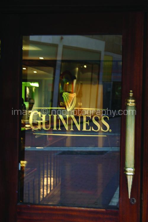 Guinness sign on glass door, Dublin, Ireland. Slightly blurred.