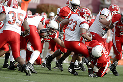 28 October 2006: James Stevenson III wraps up Marcus Mason as Cameron Siskowic lunges from the left. Youngstown State turned off over 15,000 fans as the win blew their way, cooling off Illinois State 27-13. Nationally ranked teams Youngstown State Penguins and Illinois State Redbirds competed at Hancock Stadium on the campus of Illinois State University in Normal Illinois.<br />