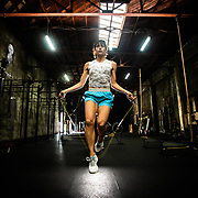 Female athlete jumping rope in a gym in San Diego, CA.