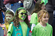Pine Bush, New York - A group of girl scouts march down Main Street during the parade at the Pine Bush UFO Fair on  on April 26, 2014.
