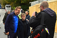 AFC Wimbledon manager Neal Ardley having a photo with a young fan on arrival at Home Park stadium before the EFL Sky Bet League 1 match between Plymouth Argyle and AFC Wimbledon at Home Park, Plymouth, England on 6 October 2018.