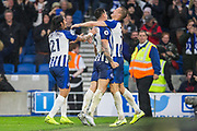 Leondro Trossard (Brighton) is celebrated by Ezequiel Schelotto (Brighton), Lewis Dunk (Capt) (Brighton) & Dan Burn (Brighton) during the Premier League match between Brighton and Hove Albion and Everton at the American Express Community Stadium, Brighton and Hove, England on 26 October 2019.