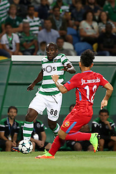 August 15, 2017 - Lisbon, Portugal - Sporting's forward Seydou Doumbia from Ivory Coastvies with Steaua's defender Junior Morais from Brasil (L) during the UEFA Champions League play-offs first leg football match between Sporting CP and FC Steaua Bucuresti at the Alvalade stadium in Lisbon, Portugal on August 15, 2017. (Credit Image: © Pedro Fiuza/NurPhoto via ZUMA Press)
