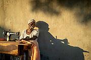 Portrait of woman sewing outside, Musoto, Mbale, Uganda