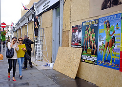 © Licensed to London News Pictures. 25/08/2012. London, UK Shops and premises are boarded up today 25th August 2012 ahead of the Notting Hill Carnival which takes place this weekend.  Photo credit : Stephen Simpson/LNP