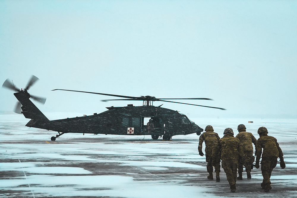 """Hot Load Training with 2-87 Infantry and C Co. 3-10 GSAB """"Mountain Dustoff"""" during a blizzard at Ft. Drum, NY"""