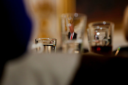 Attendees listen while U.S. President Donald Trump, seen through glasses, speaks at the National Governors Association meeting in the State Dining Room of the White House, Washington, DC, February 27, 2017. (Pool / Aude Guerrucci)