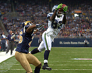 Seattle wide receiver Deion Branch (83) catches a 14-yard touchdown pass over St. Louis Rams defensive back Tye Hill (26) in the first quarter at the Edward Jones Dome in St. Louis, Missouri, October 15, 2006.  The Seahawks beat the Rams 30-27.<br />