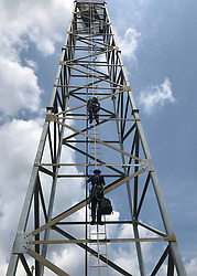 U.S. Coast Guard Petty Officer 3rd Class Zachary Hensley, a machinery technician, and Petty Officer 3rd Class Conner Johnson, a boatswains mate, stationed at Coast Guard Aids to Navigation Team Galveston in Texas, climb a 120-foot range light on Bolivar Pennisula, Texas, Sept. 3, 2017. The Coast Guard crews contiunue to work closely with federal, state, local and industry partners to ensure the rapid recovery of ports and navigational aids affected by Hurricane Harvey. (U.S. Coast Guard photo by Petty Officer 3rd Class Jordan Akiyama)  Please note: Fees charged by the agency are for the agency's services only, and do not, nor are they intended to, convey to the user any ownership of Copyright or License in the material. The agency does not claim any ownership including but not limited to Copyright or License in the attached material. By publishing this material you expressly agree to indemnify and to hold the agency and its directors, shareholders and employees harmless from any loss, claims, damages, demands, expenses (including legal fees), or any causes of action or allegation against the agency arising out of or connected in any way with publication of the material.