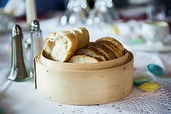 Bread basket on restaurant table, Bavaria, Germany