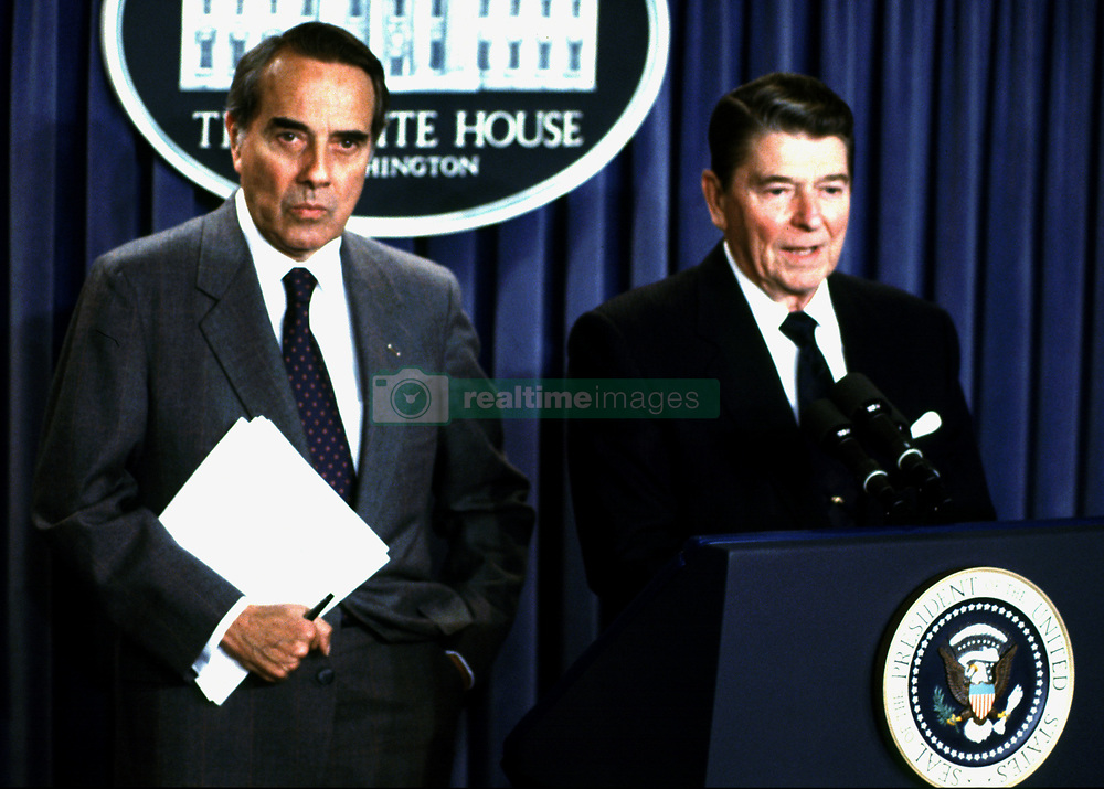 United States President Ronald Reagan, right, makes a statement to announce the support of U.S. Senate Republican Leader Bob Dole (Republican of Kansas), left, for the passage of the Intermediate-Range Nuclear Forces Treaty (INF) Treaty recently signed with the Soviet Union, in the White House Press Briefing Room in Washington, DC on December 17, 1987..Credit: Arnie Sachs / CNP