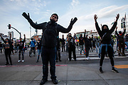 SAN FRANCISCO, CA - MAY 31: Demonstrators hold their hands up during a protest over the police killing of George Floyd, outside City Hall in San Francisco, California on May 31, 2020. - The United States has erupted into days and nights of protests, violence, and looting, following the death of George Floyd after he was detained and held down by a knee to his neck, dying shortly after. (Photo by Philip Pacheco / Agence France-Presse / AFP)