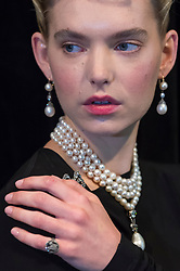 "© Licensed to London News Pictures. 19/10/2018. LONDON, UK. A model wears Marie Antoinette's jewels comprising (L to R) a monogrammed ring containing a lock of the queen's hair (Est. USD8k-10k), a diamond brooch, second half of the 18th century (Est. USD 50k-80k), a pair of natural and pearl diamond pendant earrings, late 18th century (Est USD200k-300k), a natural pearl and diamond necklace comprising three rows of 116 graduated pearls (Est USD200k-300k), a natural pearl and diamond necklace (Est USD40k-70k), and ""Queen Marie Antoinette's Pearl"", a natural pearl and diamond pendant 18th century set (Est USD1m-2m).  Preview of Sotheby's ""Royal Jewels from the Bourbon-Parma Family"", a family descended from Louis XIV of France, the Holy Roman Emperors and from Pope Paul III, with links to the most important ruling families of Europe. Led by a breath-taking group of jewels which once belonged to Marie Antoinette, queen of France, the collection of jewels will be offered for sale at Sotheby's in Geneva on 14 November 2018.  Photo credit: Stephen Chung/LNP"