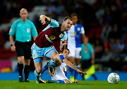 Blackburn Rovers' Peter Whittingham (right) in action with Burnley's Ashley Barnes during the Carabao Cup, Second Round match at Ewood Park, Blackburn.