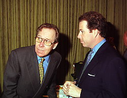 Left to right, the EARL OF SNOWDON and his son VISCOUNT LINLEY, at a party in London on 15th April 1999.MRC 22