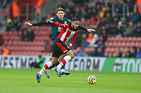 Football - 2019 / 2020 Premier League - Southampton vs. Burnley<br /> <br /> Jeff Hendrick of Burnley tussles with Southampton's Sofiane Boufal during the Premier League match at St Mary's Stadium Southampton <br /> <br /> COLORSPORT/SHAUN BOGGUST