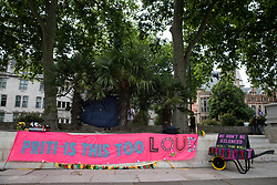 London, UK. 5th July, 2021. A pink banner referring to Home Secretary Priti Patel is displayed in Parliament Square during a Kill The Bill protest against the Police, Crime, Sentencing and Courts (PCSC) Bill 2021 as MPs consider amendments to the Bill in the House of Commons. The PCSC Bill would grant the police a range of new discretionary powers to shut down protests.