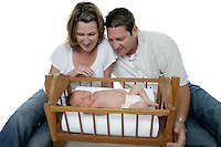 21 July 2008: New parents Troy Hall (37), Judi Hall (34) watch over their newborn  baby boy Lincoln Anthony Hall in the studio for a family portrait sessio