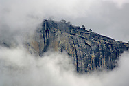 Clouds forming near the summit and sheer cliff walls of El Capitan, Yosemite Valley, Yosemite National Park, California