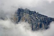 Clouds forming near the summit and sheer cliff walls of El Capitan, Yosemite Valley, Yosemite National Park, California