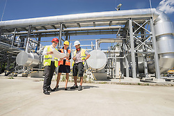 Engineer with his colleagues in meeting at geothermal power station, Bavaria, Germany