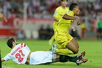 Villareal's Uche (R) and Nico Pareja (L) during the match between Sevilla FC and Villarreal day 9 spanish  BBVA League 2014-2015 day 5, played at Sanchez Pizjuan stadium in Seville, Spain. (PHOTO: CARLOS BOUZA / BOUZA PRESS / ALTER PHOTOS)