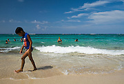 A boys walks down Maguana beach, near Baracoa, Cuba on Sunday July 13, 2008.