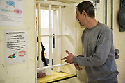 A prisoner visiting the prisoner nurse to get his daily medication. HMP/YOI Portland, Dorset. A resettlement prison with a capacity for 530 prisoners. Portland, Dorset, United Kingdom.