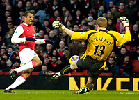 Photo: Ed Godden/Sportsbeat Images.<br /> Arsenal v Wigan Athletic. The Barclays Premiership. 11/02/2007. Arsenal's Gilberto (L), has his shot on goal saved by Wigan keeper Chris Kirkland.