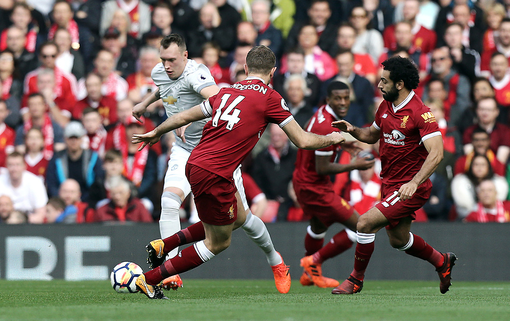 Manchester United's Phil Jones looks to run fast Liverpool's Jordan Henderson<br /> <br /> Photographer Rich Linley/CameraSport<br /> <br /> The Premier League - Liverpool v Manchester United - Saturday 14th October 2017 - Anfield - Liverpool<br /> <br /> World Copyright © 2017 CameraSport. All rights reserved. 43 Linden Ave. Countesthorpe. Leicester. England. LE8 5PG - Tel: +44 (0) 116 277 4147 - admin@camerasport.com - www.camerasport.com