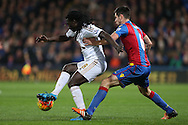 Bafetimbi Gomis of Swansea City blocking the ball from Scott Dann of Crystal Palace. Barclays Premier League match, Crystal Palace v Swansea city at Selhurst Park in London on Monday 28th December 2015.<br /> pic by John Patrick Fletcher, Andrew Orchard sports photography.