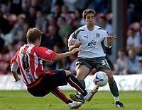 Photo: Daniel Hambury.<br />Brentford v Bristol City. Coca Cola League 1. 07/10/2006.<br />Brentford's Oli Skulason and Bristol City's Lee Johnson battle.