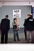 obamatucson 12 JANUARY 2011 - TUCSON, AZ: Tara Carreon (CQ) protests the war in an entryway at the University of Arizona stadium Wednesday when it was used for overflow seating during the Together We Thrive Tucson & America event on University of Arizona campus. Tens of thousands of people filed into the stadium to hear President Obama speak. The service is for the victims of Saturday's mass shooting at a Safeway in Tucson. She said he sign reflected the Orwellian doublespeak used in American politics.       ARIZONA REPUBLIC PHOTO BY JACK KURTZ..Gabrielle Giffords shooting, mass shooting,