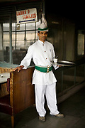 A portrait of a waiter with a turbaned headress and cumberbund in the Indian Coffee House, Baba Kharak Singh Marg, New Delhi.<br /> The Coffee House dates back almost fifty years, first in central Connaught Place, then Janpath and now at the top of a rather shabby shopping centre. Still run by the Indian Coffee Workers Cooperative Society, it was a regular haunt for politicos in Delhi and It's clientelle is still well read and intellectual.