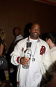 Damon Dash with a bottle of the vodka he is promoting, Rocawear UK launch, 5 Cavendish Sq. © Copyright Photograph by Dafydd Jones 66 Stockwell Park Rd. London SW9 0DA Tel 020 7733 0108 www.dafjones.com