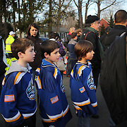 Ashton Boltes, Matthew Bradley and Stephen Turchetta in Ice Hockey shirts  at the shrine created under the school sign in Sandy Hook after yesterday's shootings at Sandy Hook Elementary School, Newtown, Connecticut, USA. 15th December 2012. Photo Tim Clayton