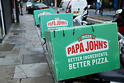 Papa Johns pizza delivery courier bike boxes on 14th August 2020 in London, United Kingdom. Papa Johns is an American pizza restaurant franchise. It is the fourth largest pizza delivery restaurant chain in the United States.
